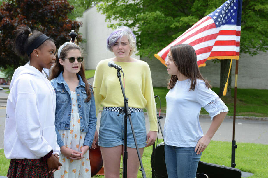 "Mackenzie Coffield of Stamford, Elsa Franks of Stamford, Charlotte Price of Greenwich and Kathryn Thompson of Darien led the singing of ""One Voice"" when New Canaan Country School broke ground on its new Athletics and Wellness Center on Friday, May 24, 2019. Contributed photo / Connecticut Post"
