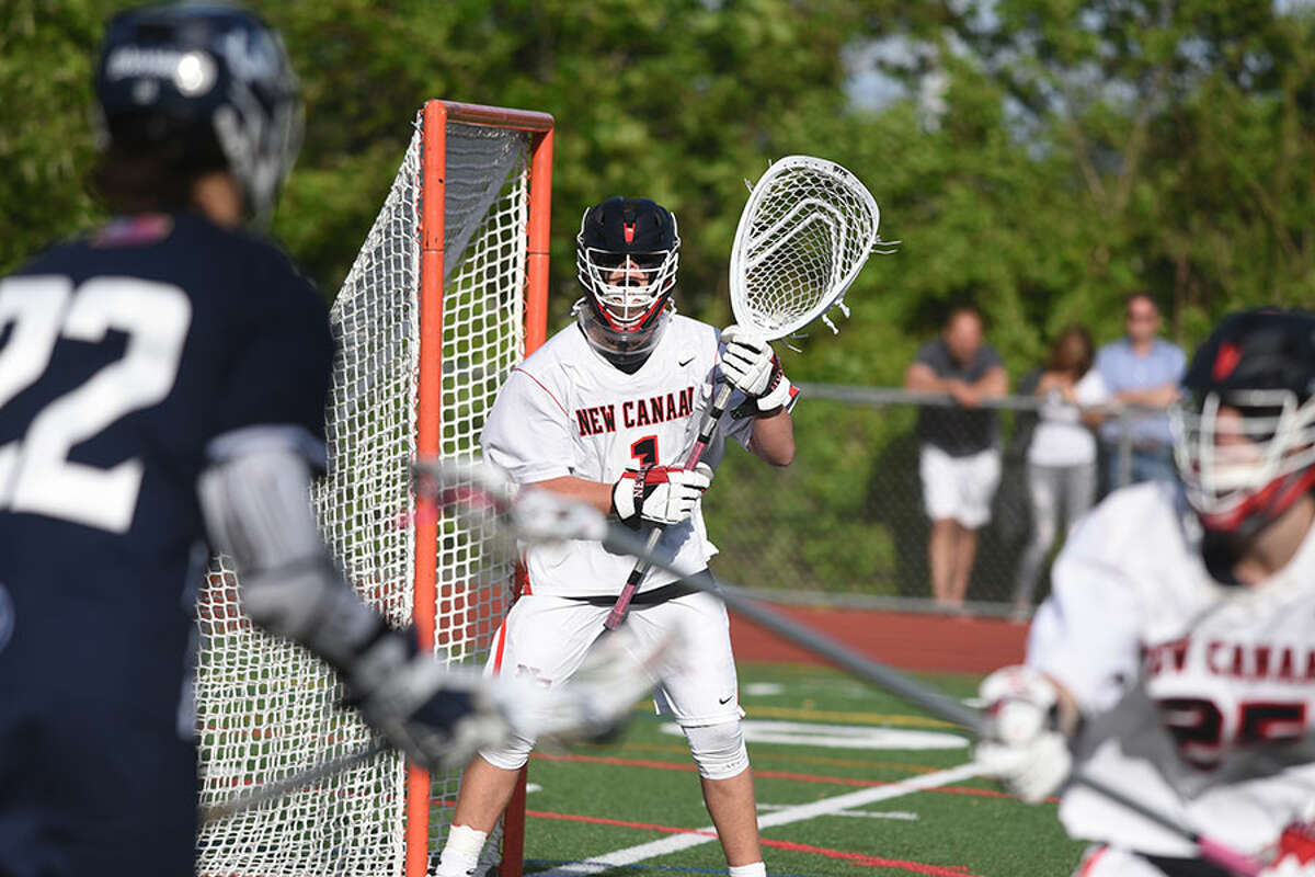 New Canaan senior co-captain Carl Mazabras stays focused on the action during the FCIAC boys lacrosse final at Brien McMahon High School on Friday, - Dave Stewart/Hearst Connecticut Media