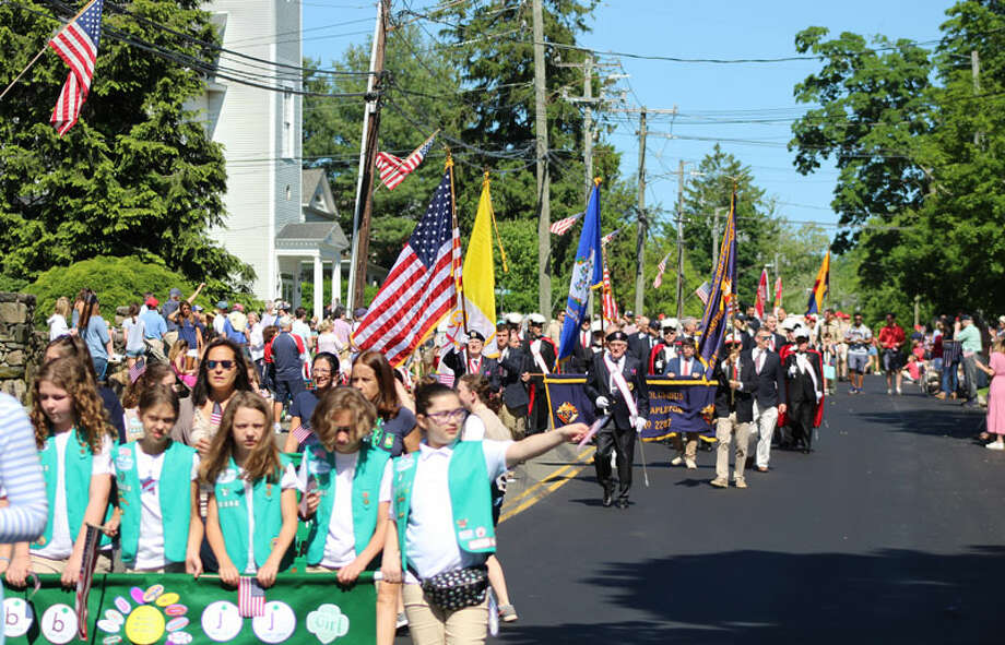 New Canaan residents march down Main Street on Monday, May 27, in observance of Memorial Day. — John Kovach photo