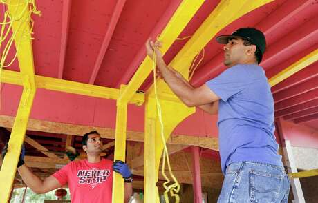 Members of the Orissa Culture Center unpack the parts of a deity chariot from storage. When assembled, the float sized display is pushed on a trailer by volunteers and is being refurbished and painted at the center's property in south Houston Saturday, Jun. 22, 2019, in preparation for the upcoming 12th Annual Hindu Chariot Festival, also known as Rath Jatra. The float was originally designed and built in 2014, and is stored in pieces at the center between the annual chariot festivals.