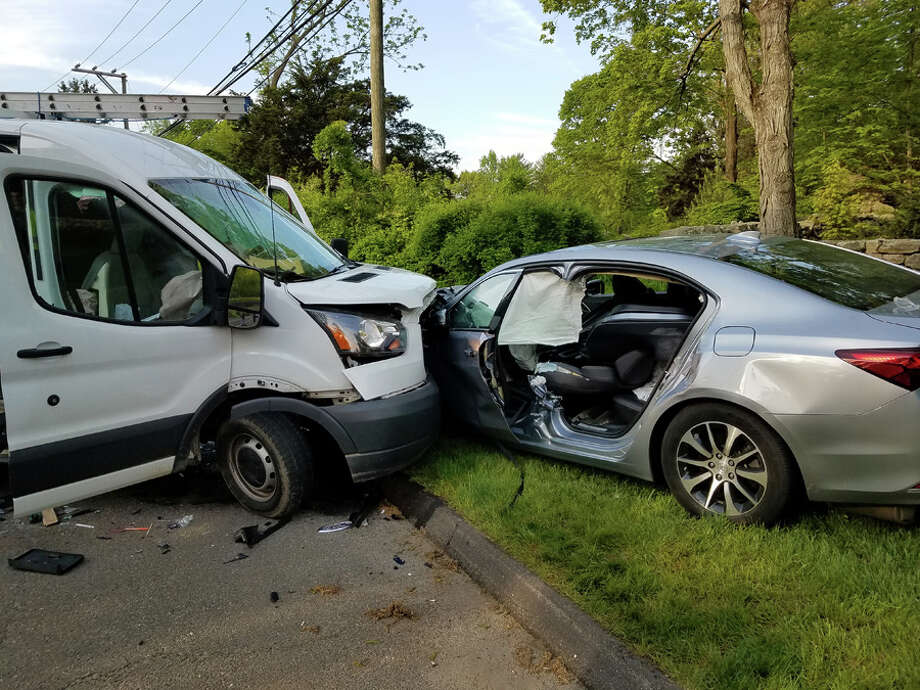 Pictured is the scene of a head-on crash on Smith Ridge Road in New Canaan early Friday, May 17, 2019. New Canaan Fire Department / Contributed photo