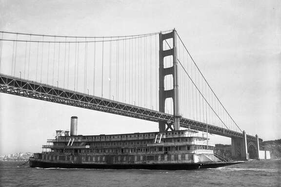 The Delta King passes under the Golden Gate Bridge while returning from British Columbia, 1959