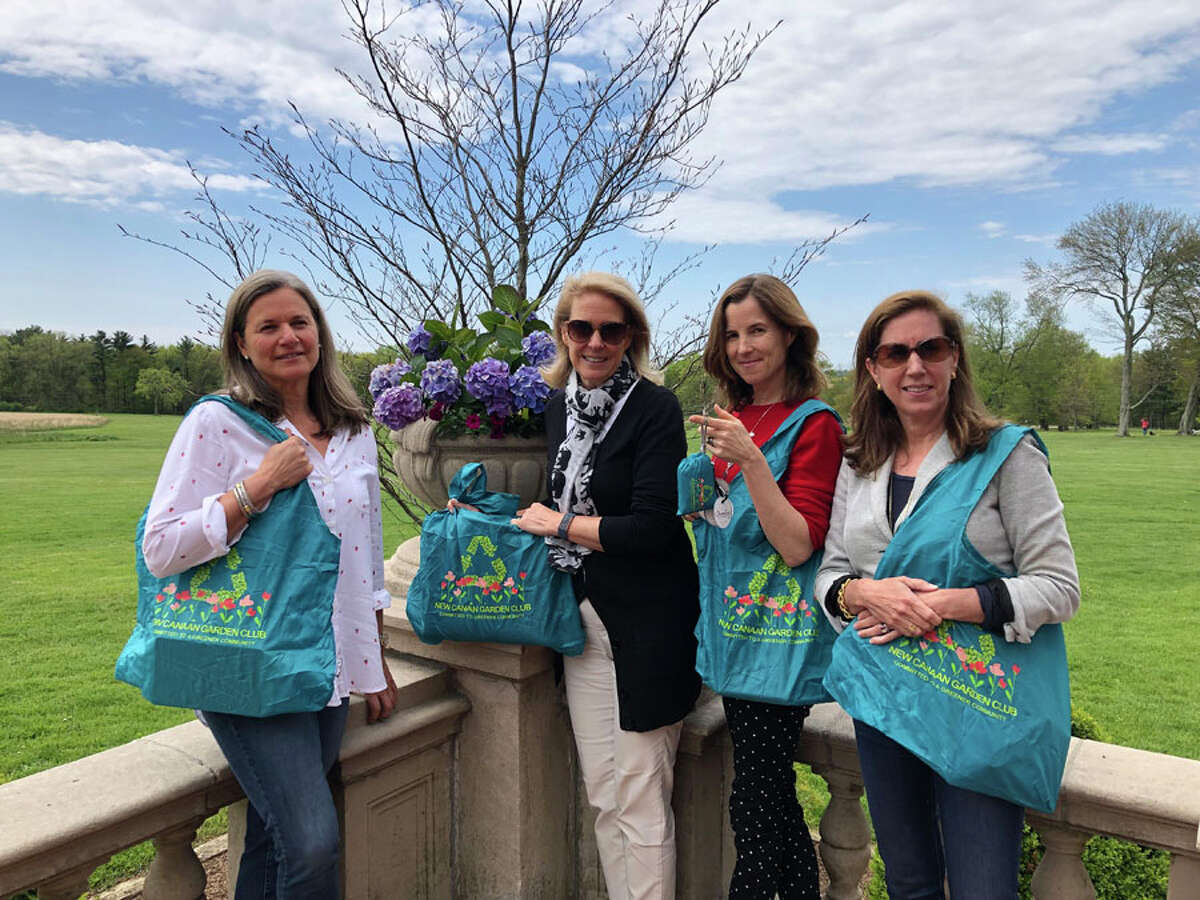 New Canaan Garden Club Conservation Committee members (from left) Jo Ziesing, Tracy Merrill, Wendy Dewey and Julie Peter are responsible for producing reusable bags being distributed by the organization. Contributed photo