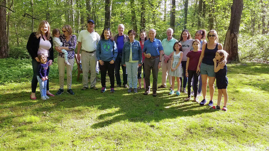 Well-wishers gathered at the Bristow Preserve Saturday, May 11, as four bluebirds and a cedar wax wing, which had been nursed back to health, were set free. Wildlife in Crisis / Contributed photo / New Canaan Advertiser Contributed