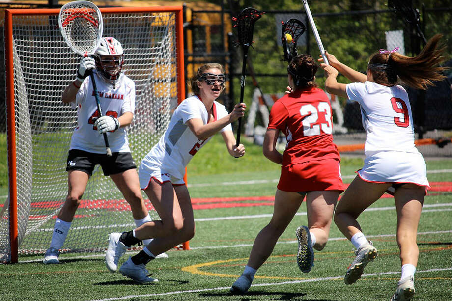 New Canaan's Caroline Schuh (20) and Katelyn Sparks (9) defends against a shot by Greenwich's Jess Ware (23) during a girls lacrosse game at Dunning Field in New Canaan on Saturday, May 11, 2019. — Terry Dinan/For Hearst Connecticut Media / Hearst Connecticut Media