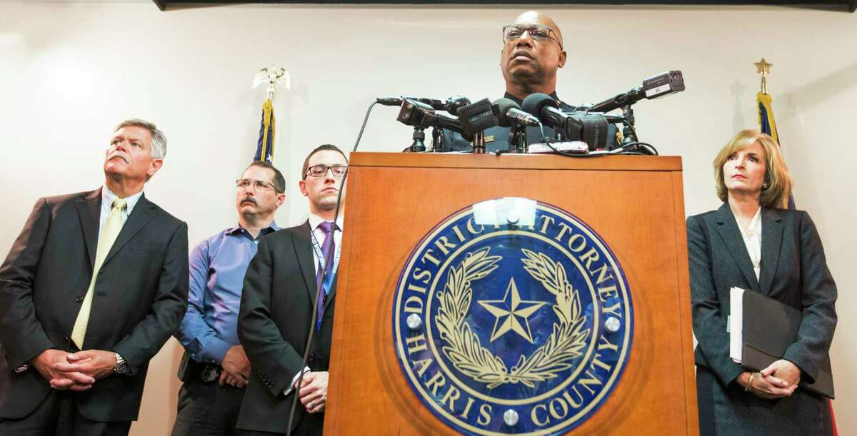In this 2015 photo, then-Houston Police Chief Charles McClelland, with then-Harris County District Attorney Devon Anderson, right, speaks during a news conference announcing that the conviction of Alfred Dewayne Brown was thrown out by an appeals court. Brown's conviction and death sentence, involving the 2003 fatal shooting of Houston Police officer Charles Clark was reversed, based on evidence withheld by prosecutors.