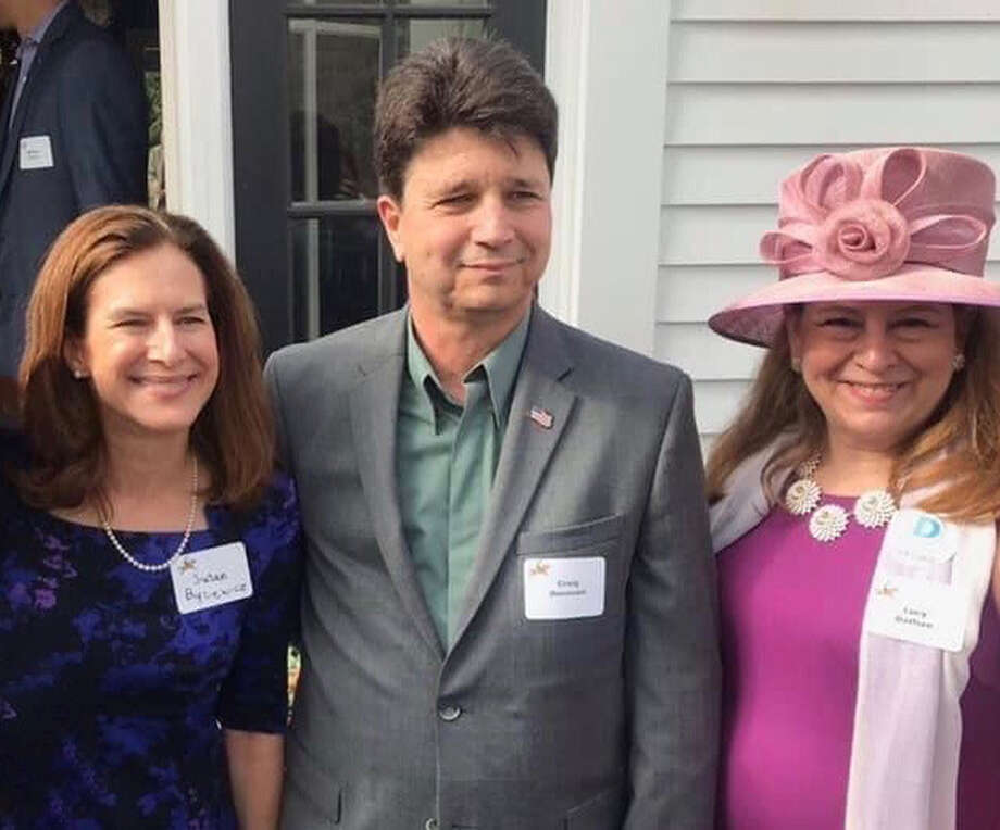 Lt. Gov. Susan Bysiewicz joins Democratic first selectman candidate Craig Donovan and State Rep. Lucy Dathan during Saturday's Derby for Democracy Party hosted by The New Canaan Democrats at a private home. Contributed photo / Connecticut Post