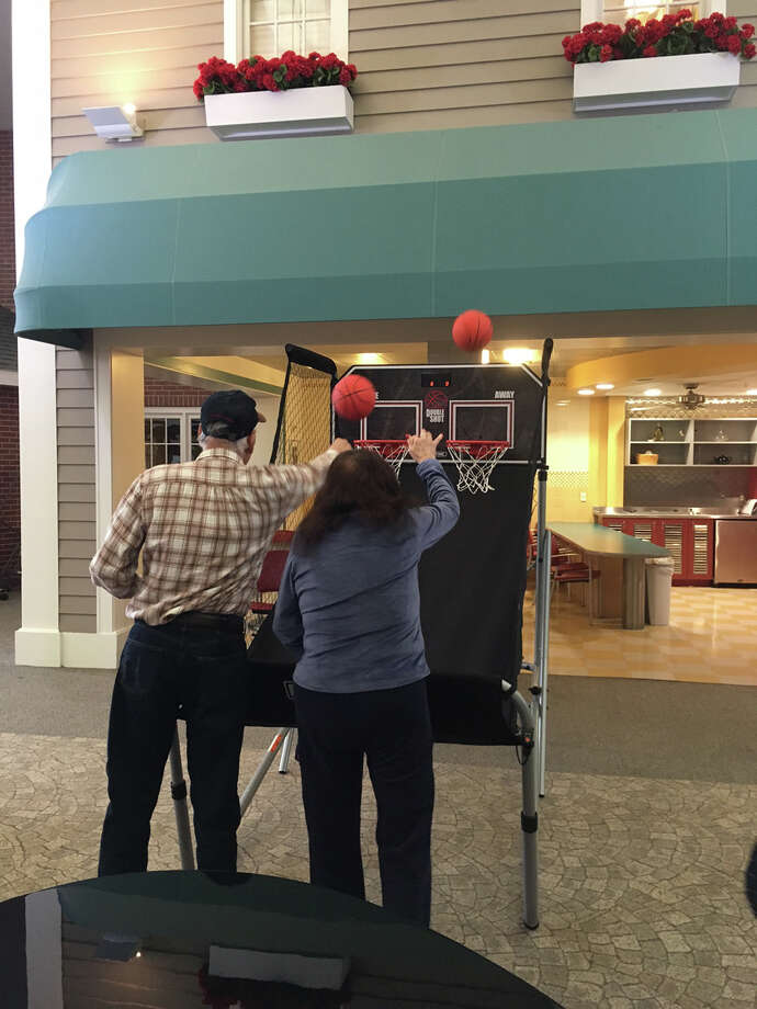 The Pop-a-Shot game used at the recent March Madness-themed fundraiser for A Better Chance has been donated to Waveny so residents can shoot hoops. Contributed photo / Connecticut Post
