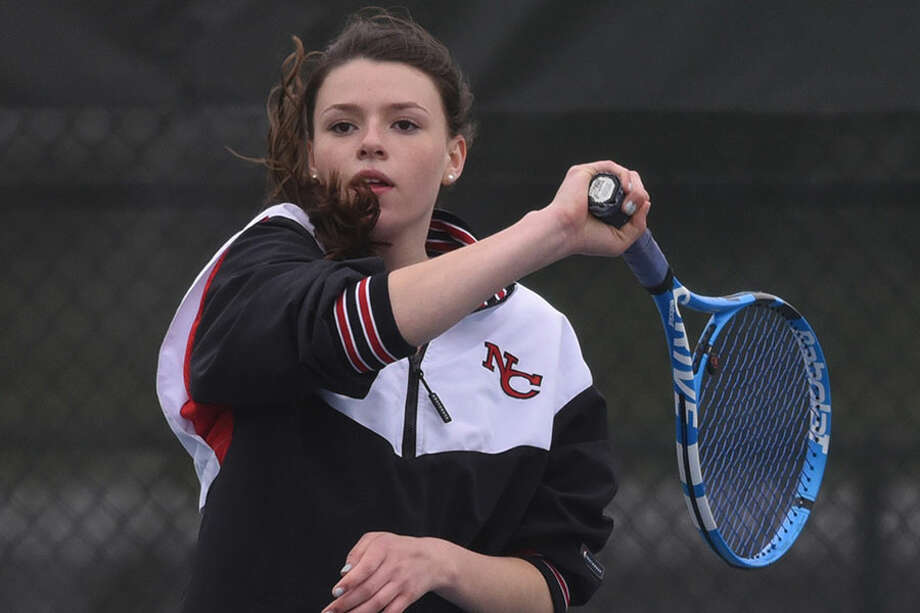 New Canaan's Imogen Smith follows through during the No. 2 doubles match in the Rams' girls tennis match against Westhill at New Canaan High School on Thursday, May 9, 2019. — Dave Stewart/Hearst Connecticut Media / Hearst Connecticut Media