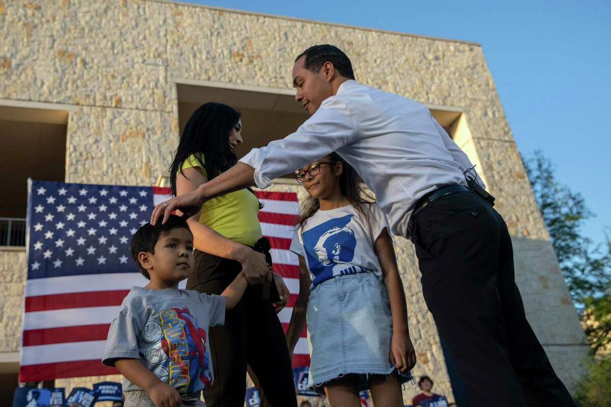 **EMBARGO: No electronic distribution, Web posting or street sales before 3:00 a.m. ET Sunday June 16, 2019. No exceptions for any reasons. EMBARGO set by source.** FILE - Julián Castro ruffles his 4-year-old son Cristián's hair at his presidential campaign rally in San Antonio, April 10, 2019. Changing times have some male candidates facing the same questions women in politics have long wrestled with: how to pursue public life and parenthood at the same time? (Tamir Kalifa/The New York Times)