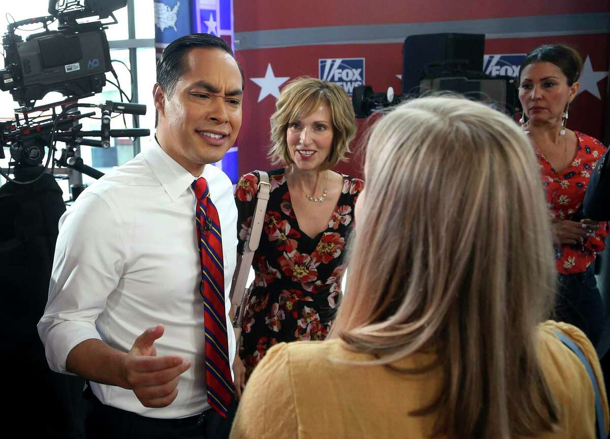 Democratic presidential candidate Julian Castro speaks to members in the crowd after a FOX News Channel town hall event, Thursday, June 13, 2019, in Tempe, Ariz. (AP Photo/Ross D. Franklin)