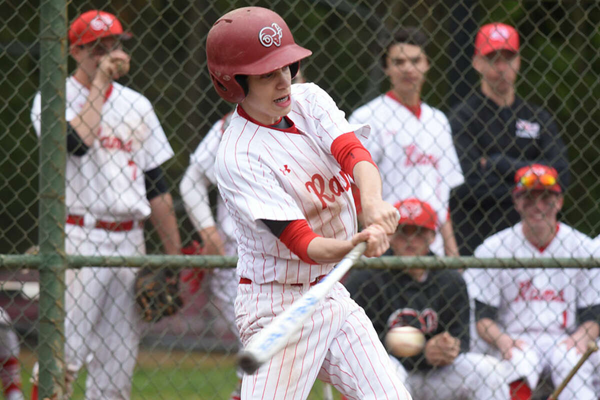 New Canaan's Jack Lisecky gets a hit during the Rams' baseball game against Darien on Friday, May 3. - Dave Stewart/Hearst Connecticut Media