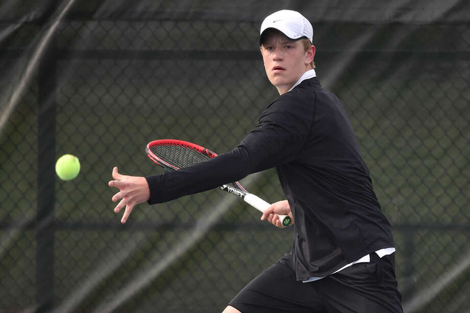 New Canaan's Matt Brand lines up a forehand shot during a boys tennis match against Darien at the New Canaan High School courts on April 29, 2019. — Dave Stewart/Hearst Connecticut Media / Hearst Connecticut Media
