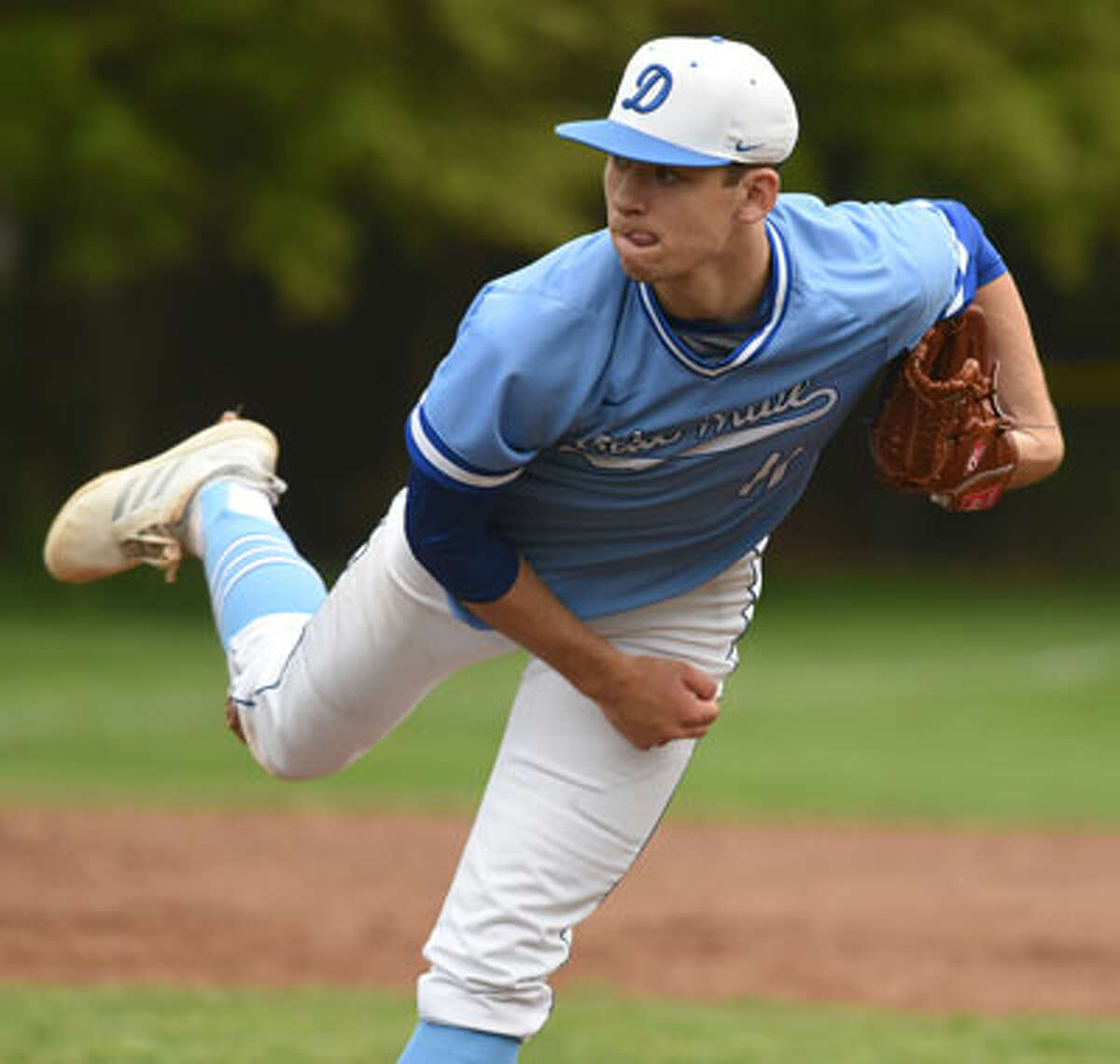 Darien's Henry Williams follows through on a pitch during the Blue Wave's baseball game against New Canaan at Mead Park in New Canaan on Friday, May 3, 2019. - Dave Stewart/Hearst Connecticut Media
