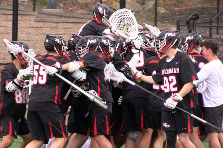 New Canaan celebrates its 15-12 victory over Fairfield Prep Saturday, May 4, 2019 at Rafferty Stadium in Fairfield. — Sean Patrick Bowley/Hearst Connecticut Media