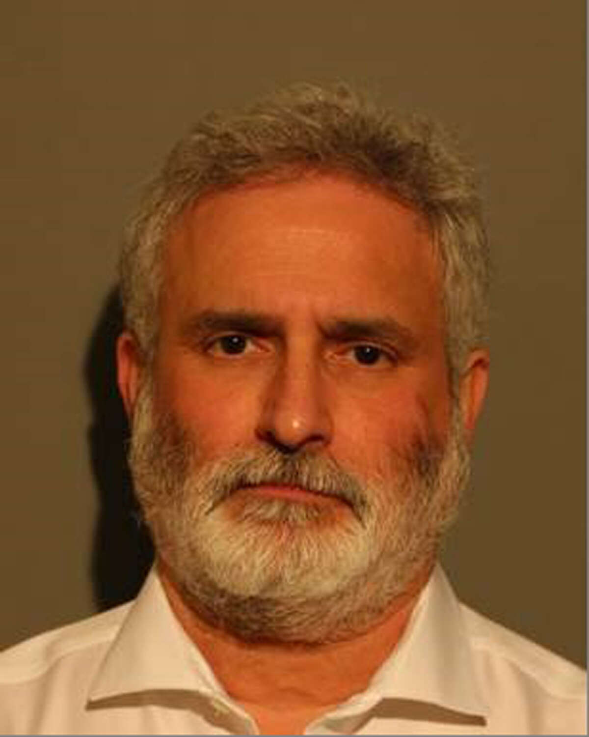 Bruce Gluck, former director of Food Services for New Canaan, has been charged with taking nearly one-half million dollars over a five-year period. New Canaan Police / Contributed photo