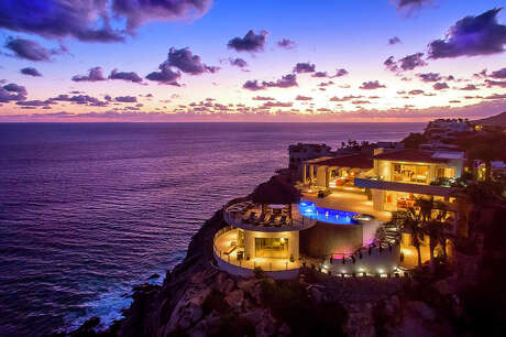 Headed to Los Cabos? Airbnb Luxe has this six-bedroom clilffside modernist mansion for $3,360 a night.
