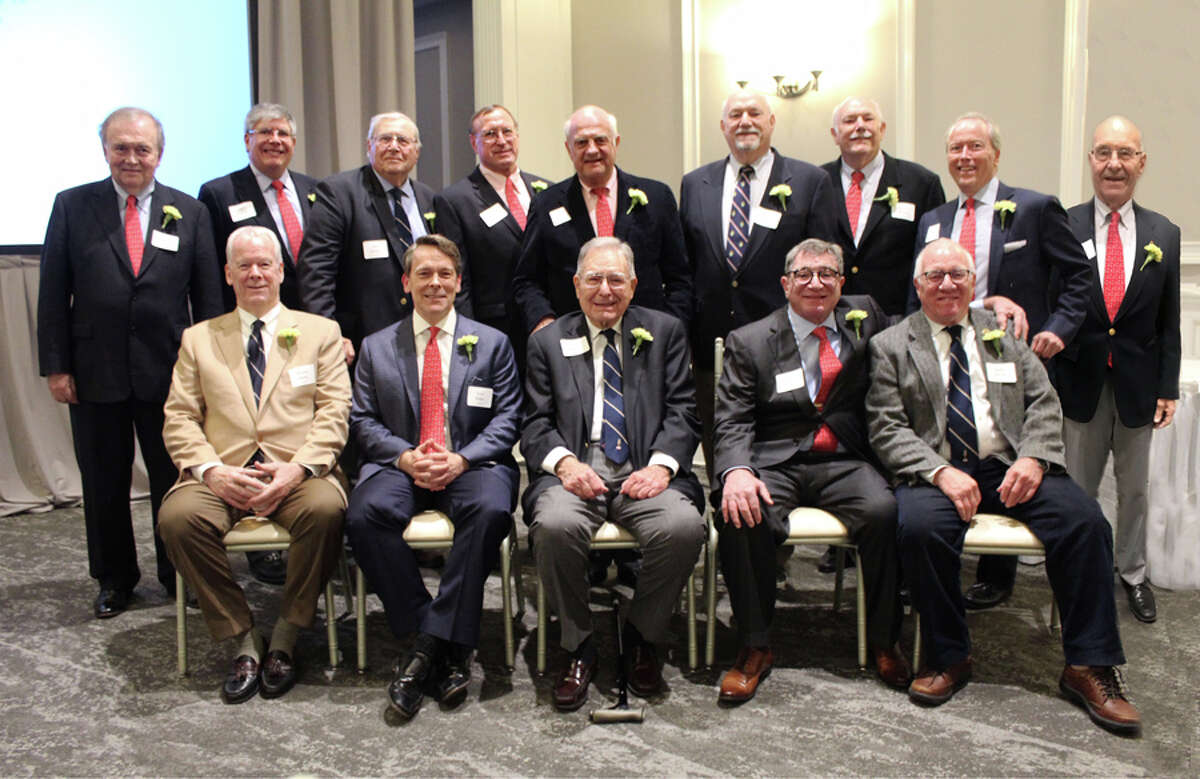 Previous Gridiron Fall Guys gathered with this year's honoree at the annual roast of a New Canaan resident. In front, from left, are Mike Hobbs, 2019 Fall Guy Scott Hobbs, Don Hersam, Rick Franco and Sperry Decew. In back are George Baker, Bill Walbert, Joe Rucci, Steve Benko, Keith Simpson, Richard Stewart, Bailey Stewart, Leo Karl III and Laszlo Papp. Contributed photo