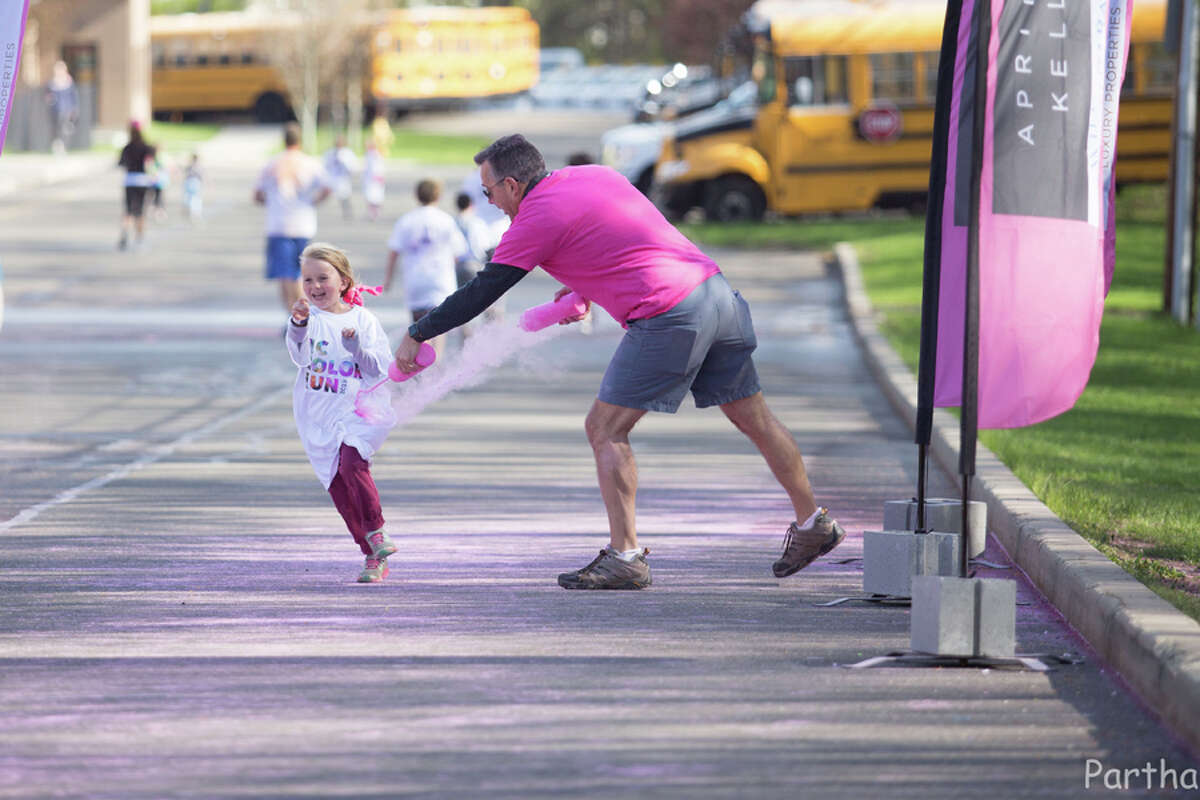 Runners were covered with washable powdered paint as they ran to raise money for scholarships in the third New Canaan Color Run Saturday, April 27. Parthasaradhi Jabitapuram / Contributed photo