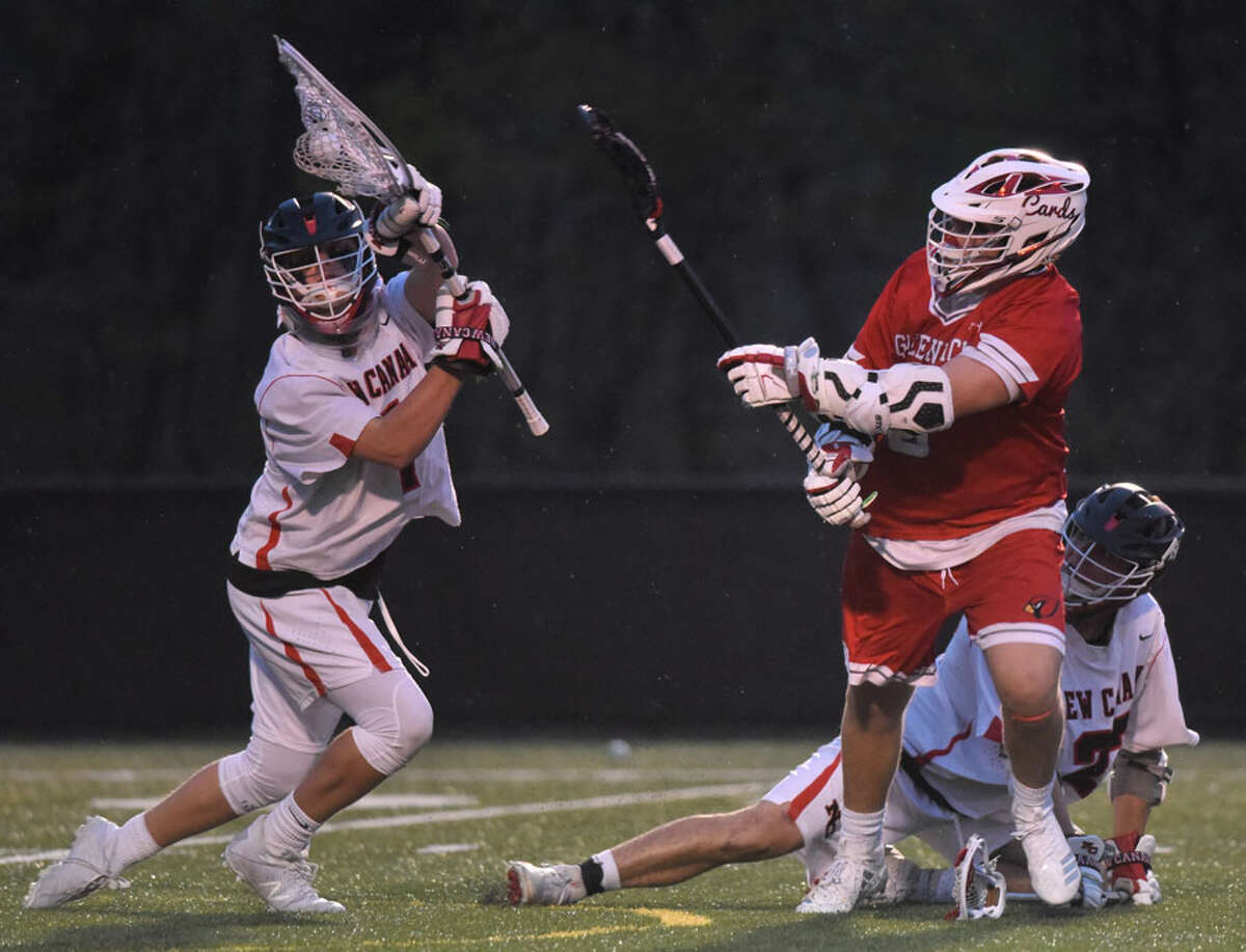 New Canaan goalie Carl Mazabras makes a point-blank save against Greenwich's Jack Feda (6) during a boys lacrosse game at Dunning Field in New Canaan on Thursday, April 25, 2019. - Dave Stewart/Hearst Connecticut Media