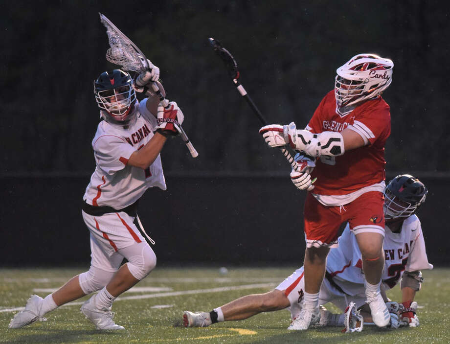 New Canaan goalie Carl Mazabras makes a point-blank save against Greenwich's Jack Feda (6) during a boys lacrosse game at Dunning Field in New Canaan on Thursday, April 25, 2019. — Dave Stewart/Hearst Connecticut Media / Hearst Connecticut Media