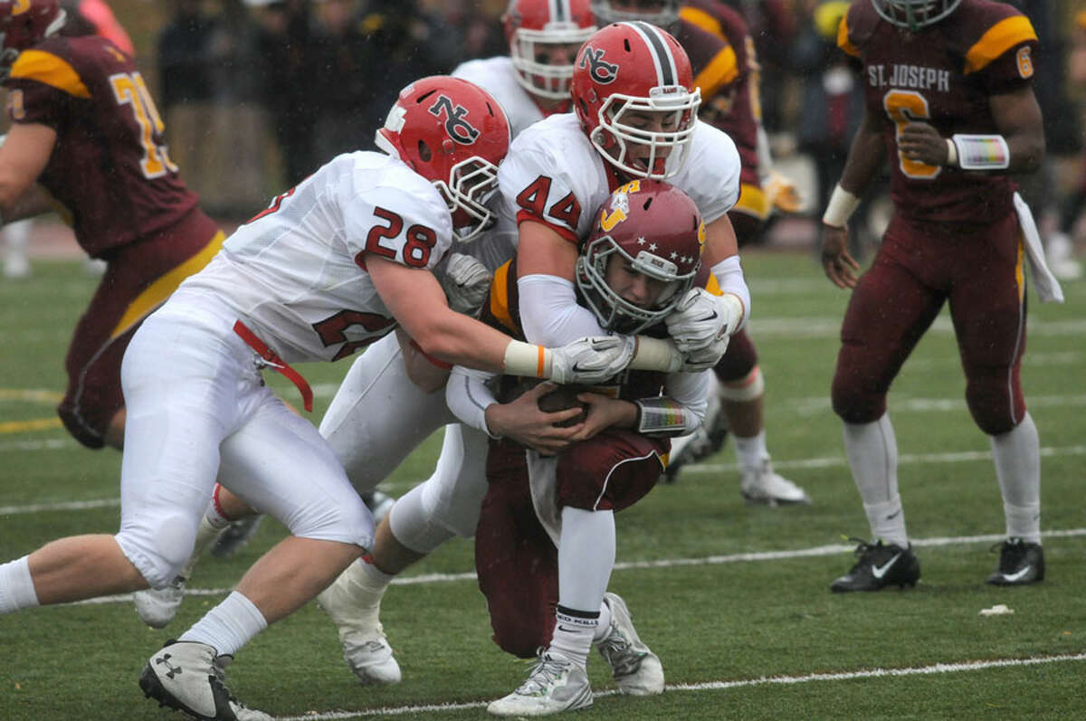 Zach Allen (44) of New Canaan sacks St. Joseph quarterback Lars Pederson during the Rams' football victory over the Cadets on Nov. 1, 2014. - Dave Stewart photo