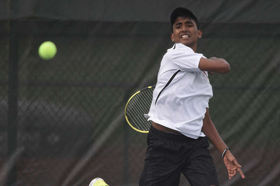 New Canaan's Sai Akavaramu follows through on a forehand shot during the No. 3 singles match in the Rams' boys tennis match against Darien at New Canaan High School on Monday, April 29, 2019. — Dave Stewart/Hearst Connecticut Media / Hearst Connecticut Media