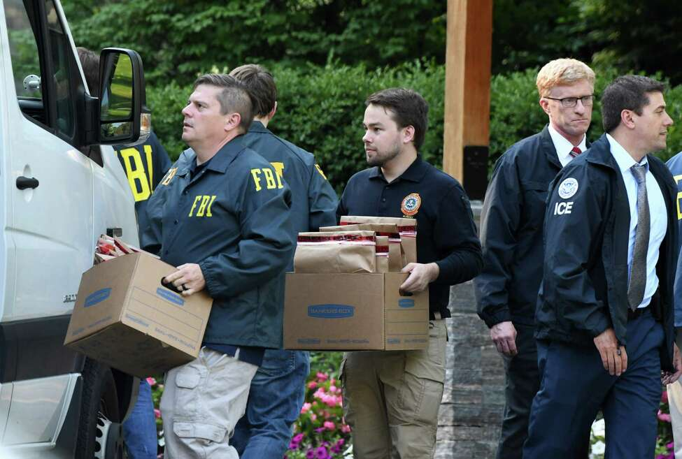 Federal agents remove evidence collected from Turbine Services Ltd. during a raid on Tuesday, June 25, 2019, on Old Gick Road in Wilton, N.Y. Agents and members of the U.S. Department of Homeland Security and Commerce Department took part in the day-long raid. (Will Waldron/Times Union)