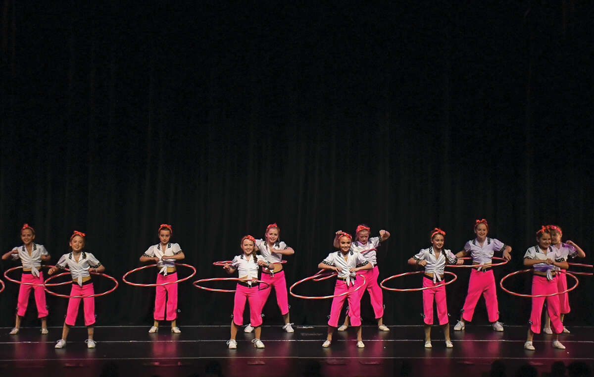 Students perform with hula hoops in the final Spring Revue for the Walter Schalk School of Dance in March 2019. -Walter Schalk School of Dance / Contributed photo