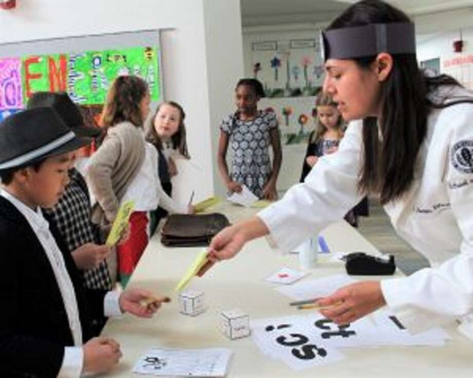 Third grade classes at New Canaan Country School in New Canaan, Connecticut recently revisited Ellis Island. in simulation. Aiden Tong of New Canaan, Emma Stern of New Canaan, Leni Schilcher of New Canaan, Kayla Mouzon of Norwalk and Lucy Anne Kurtz of Darien simulate the Ellis Island health inspection during third grade lessons at New Canaan Country School. — Contributed photo