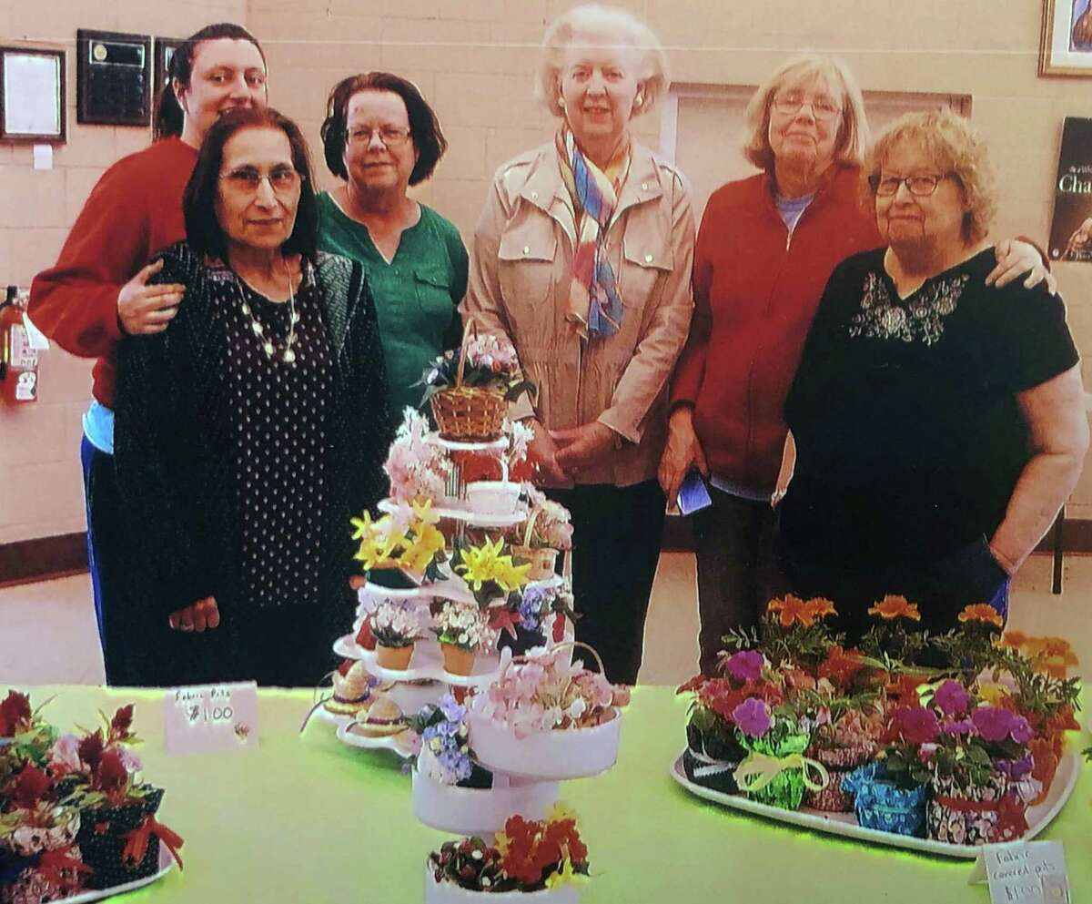 The St. Francis Women's Guild in New Milford recently held a Mother's Day plant sale. Among those present for the event were, from left to right, in front, Phyllis Gonch and Suzanne Moros, and in back, Ann Coppola, Ellen Cote, Joanne Lillis and Adrienne Coppola.
