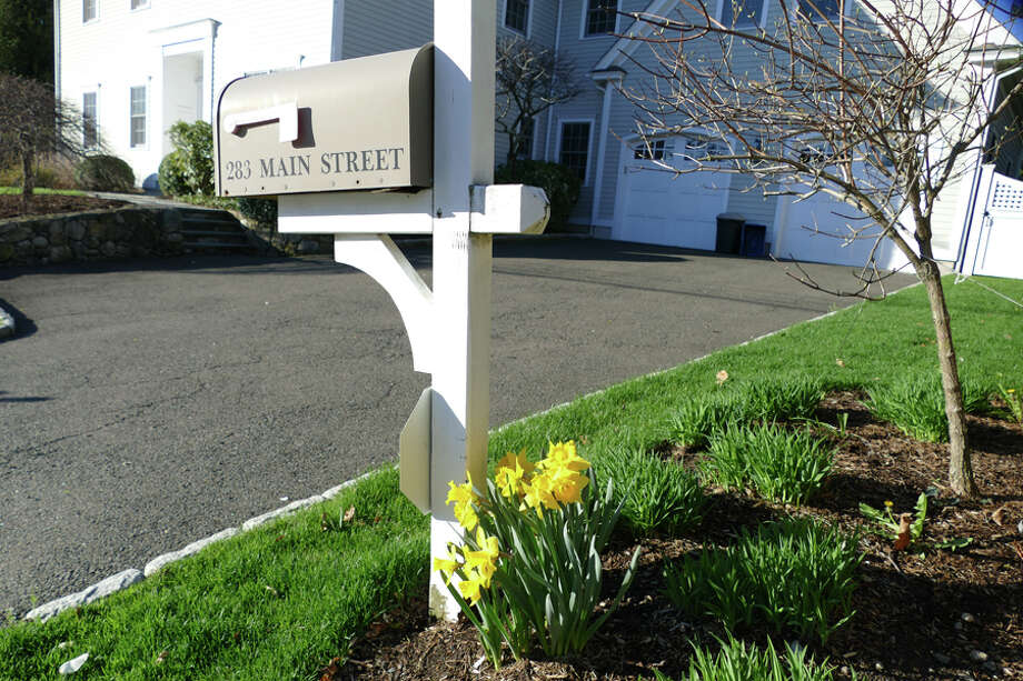 A mailbox with flowers on Main Street is another sign that warmer weather is on the way, in addition to today, April 19, 2019. — Grace Duffield / Hearst Connecticut Media / Connecticut Post