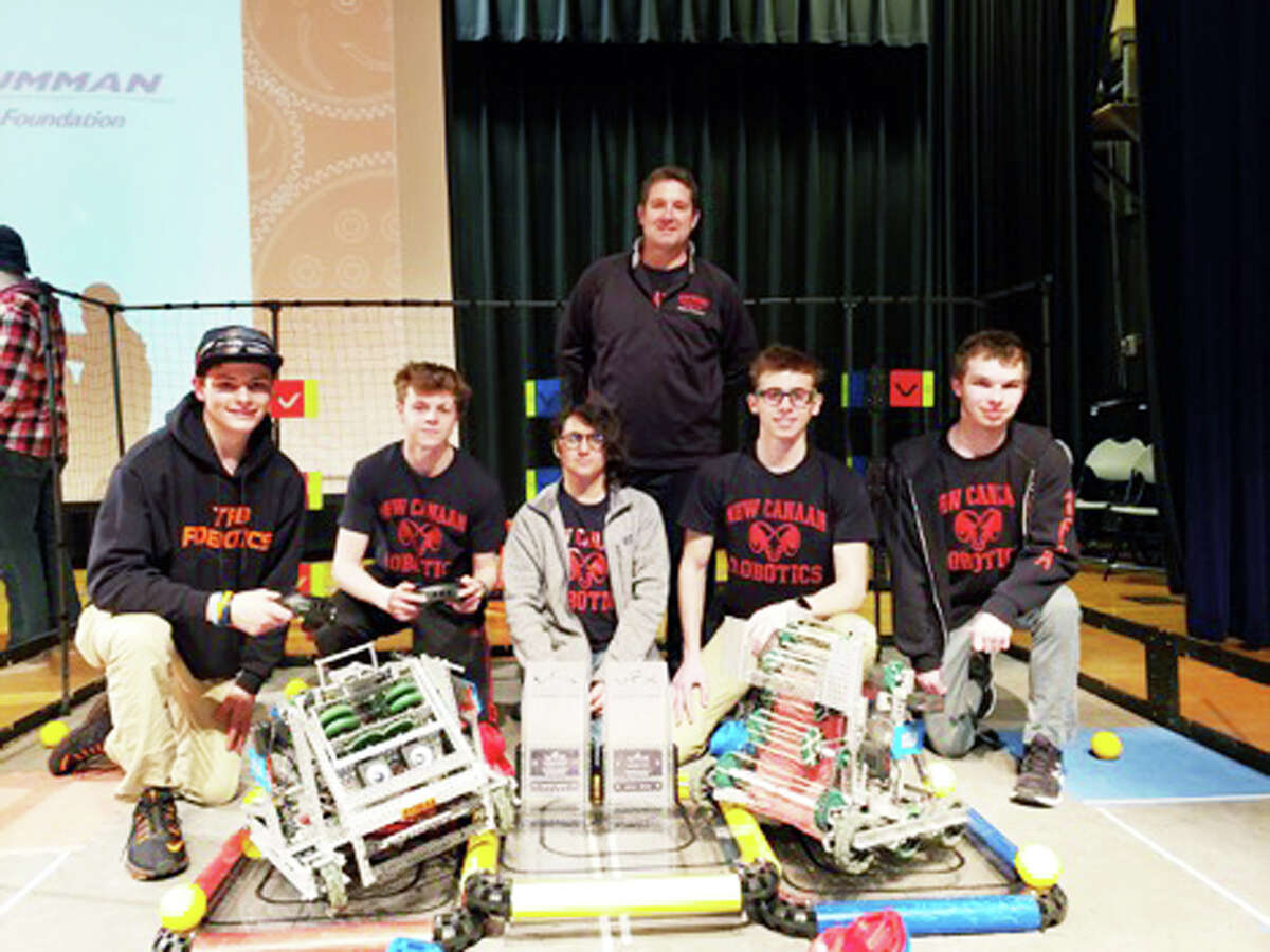 The New Canaan High School VEX Robotics Team is bound for the World Championships in Kentucky after winning the Southern New England Regional Tournament.In front, from left, are Tim Belcourt from TRB Robotics, an alliance partner; Mark Levin, Katelyn McCall, Ben Levin, and Will Robertson. In back is Jim Zambarano, VEX Robotics team adviser and NCHS Technology Ed teacher. - Contributed photo
