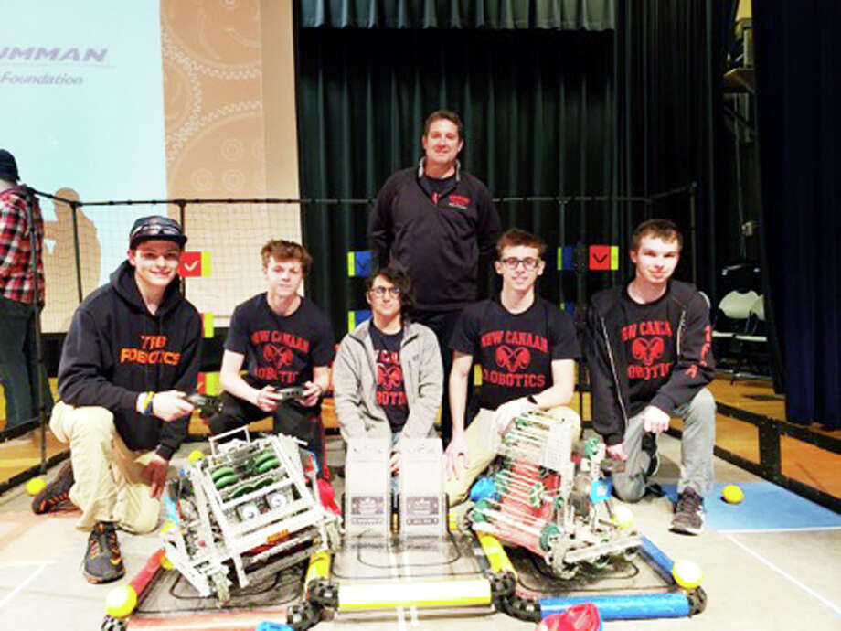 The New Canaan High School VEX Robotics Team is bound for the World Championships in Kentucky after winning the Southern New England Regional Tournament.In front, from left, are Tim Belcourt from TRB Robotics, an alliance partner; Mark Levin, Katelyn McCall, Ben Levin, and Will Robertson. In back is Jim Zambarano, VEX Robotics team adviser and NCHS Technology Ed teacher. — Contributed photo / Connecticut Post