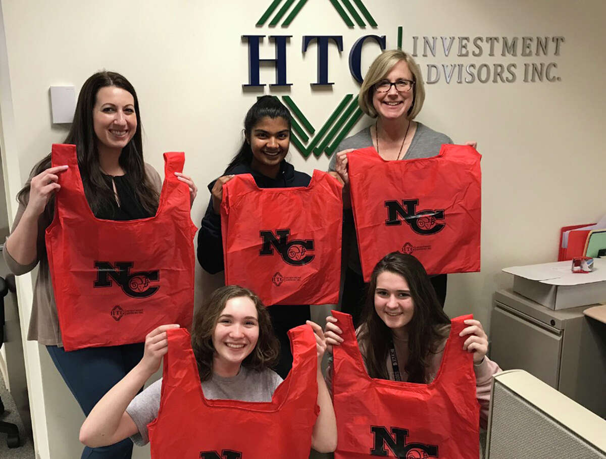 Thanks to support from HTG Investment Advisors, the New Canaan High School Save Our Seas Club will distribute reusable bags at NCHS on Monday, April 22, Earth Day. In front are Alexandra Harte and Mary Haney. In back are Casey Kaufman, Esha Dagli and Allison Donaldson. - Contributed photo
