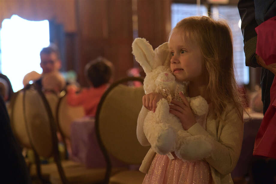 Lily Hart Horine, 4, of New Canaan, hugs a friend at the SMILE Breakfast with the Easter Bunny at Waveny House on Saturday, April 13. — Jarret Liotta / For Hearst Connecticut Media / Connecticut Post