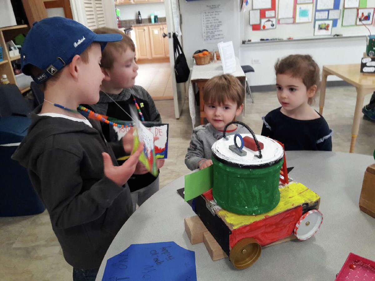Kids make polar bears in a recent activity.