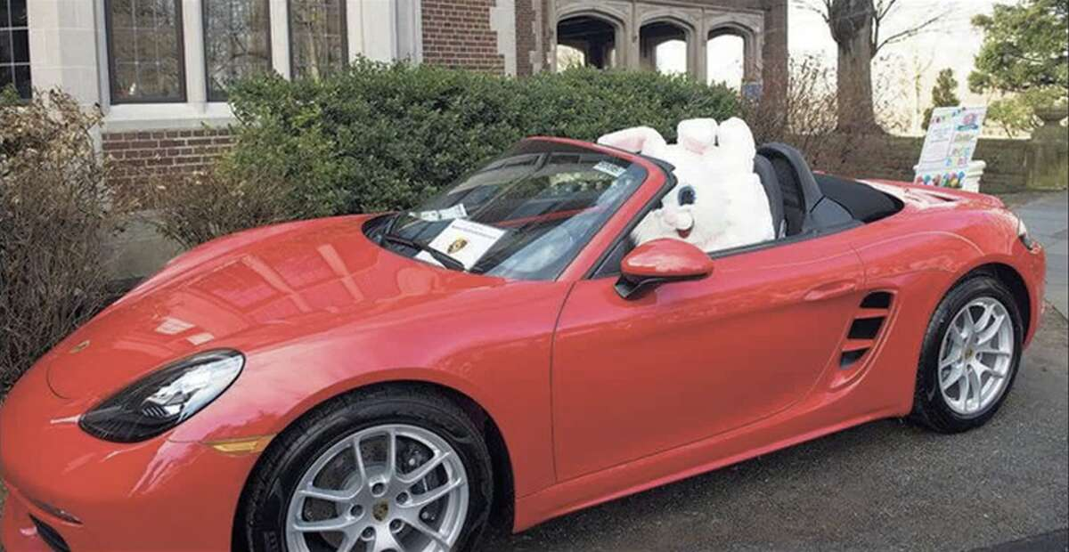 The easter bunny checks out a Porsche at Young Women's League of New Canaan's Easter Egg hunt on Saturday, April 6, 2019 at Waveny Park. - Bryan Haeffele / Hearst Connecticut Media