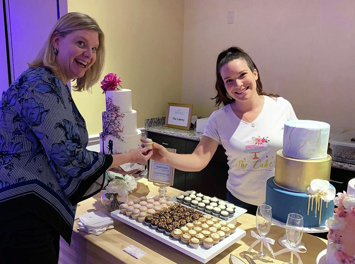Laura Roberts of Fairfield enjoys a cupcake from Natalie Rose, owner of The Cakery in Stamford, at the Pacific House Food & Wine Experience to raise money for homeless youth. Pacific House fundraiser.
