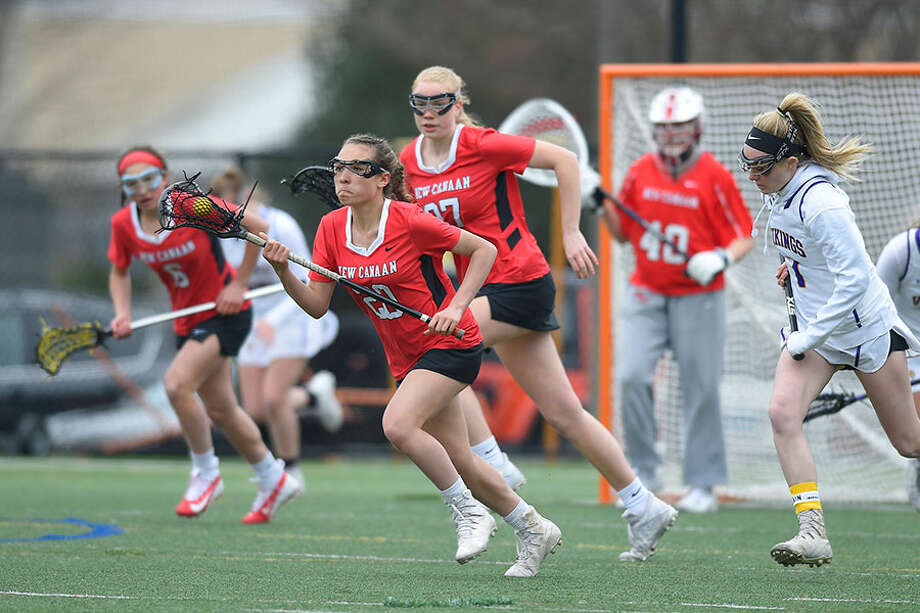 New Canaan's Quincy Connell breaks out of the defensive zone during a Ram victory over Westhill on April 2. — Matthew Brown/Hearst Connecticut Media / Stamford Advocate