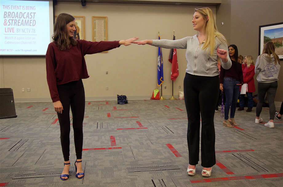 A tradition of fun and fashion took a fresh turn Friday night when New Canaan High School's Ram Jam saw its first year as a Fashion Music Festival. Jessie Penman and Becca Larkin, both 17, practice their moves for the runway in the Wagner Room for the Ram Jam Fashion Music Festival on Friday night, March 29. — Jarret Liotta / For Hearst Connecticut Media / Connecticut Post