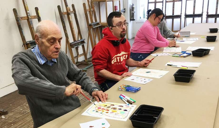 A grant to the Silvermine Arts Center will support an art program with STAR, Inc., Lighting the Way, for people with disabilities. Participants work on art in an ArtAcademy class at Silvermine Arts Center. — Silvermine Arts Center / Contributed photo