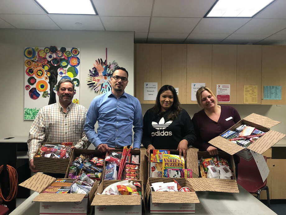 The New Canaan YMCA Togetherhood Committee's annual Adopt-A-Box project allowed community members to show thanks and appreciation for our troops. Over the last few months, the committee has gathered snacks, treats, games and much more from members throughout the community to fill nine boxes and share with troops. — Contributed photo