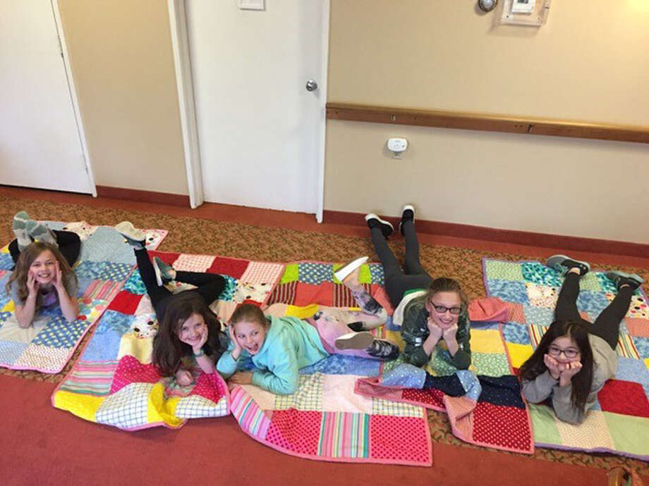 Students show off the quilts they made in a New Canaan Recreation Department quilting class taught held recently at The Inn at Waveny LifeCare. — Waveny LifeCare / Contributed photo