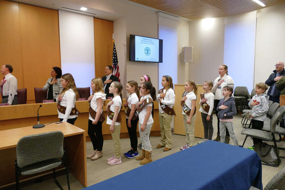 Girl Scout Troop 292 led the Town Council in the Pledge of Allegiance in keeping with the council's tradition before starting a meeting. — Grace Duffield / Hearst Connecticut Media / Connecticut Post