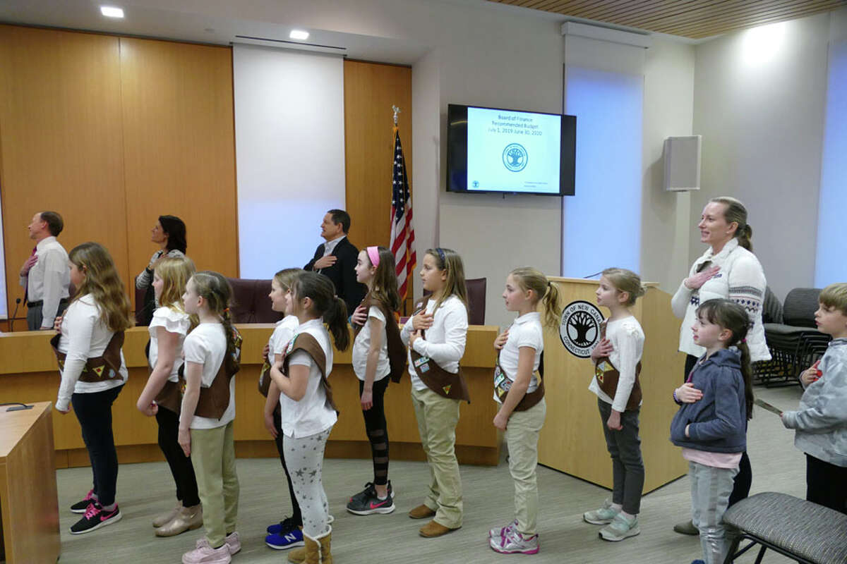 Girl Scout Troop 292 led the Town Council in the Pledge of Allegiance in keeping with the council's tradition before starting a meeting. - Grace Duffield / Hearst Connecticut Media