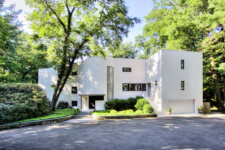 William Pitt Sotheby's International Realty agents recently hosted a combination art show and property tour at this Darien home designed by Frank Lloyd Wright collaborator Arthur Holden, which the two agents are co-listing. — William Pitt Sotheby's International Realty / Contributed photo