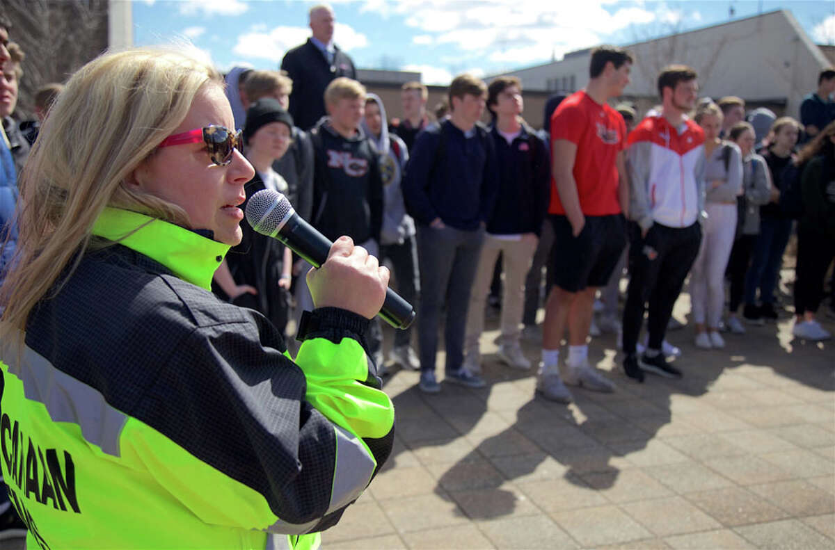 EMT Bonnie Rumilly of the New Canaan Volunteer Ambulance Corps narrates a demonstration for students. The mock crash at New Canaan High School Monday, April 1, showed the consequences of distracted driving. - Jarret Liotta / For Hearst Connecticut Media