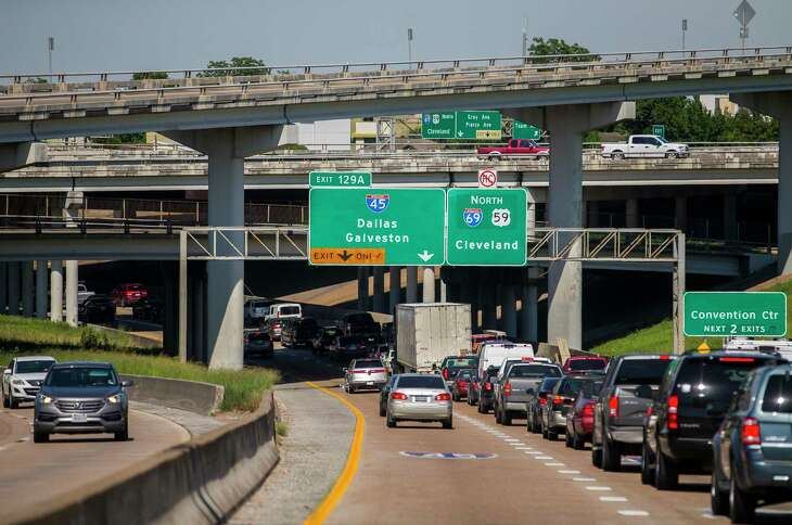 Drivers merge between lanes leading to Interstate 45 and Interstate 69 traveling northbound on I-69 in downtown Houston on June 12, 2019. Houston area commuters waste 75 hours in traffic annually, according to a new report from the Texas A&M Transportation Institute.