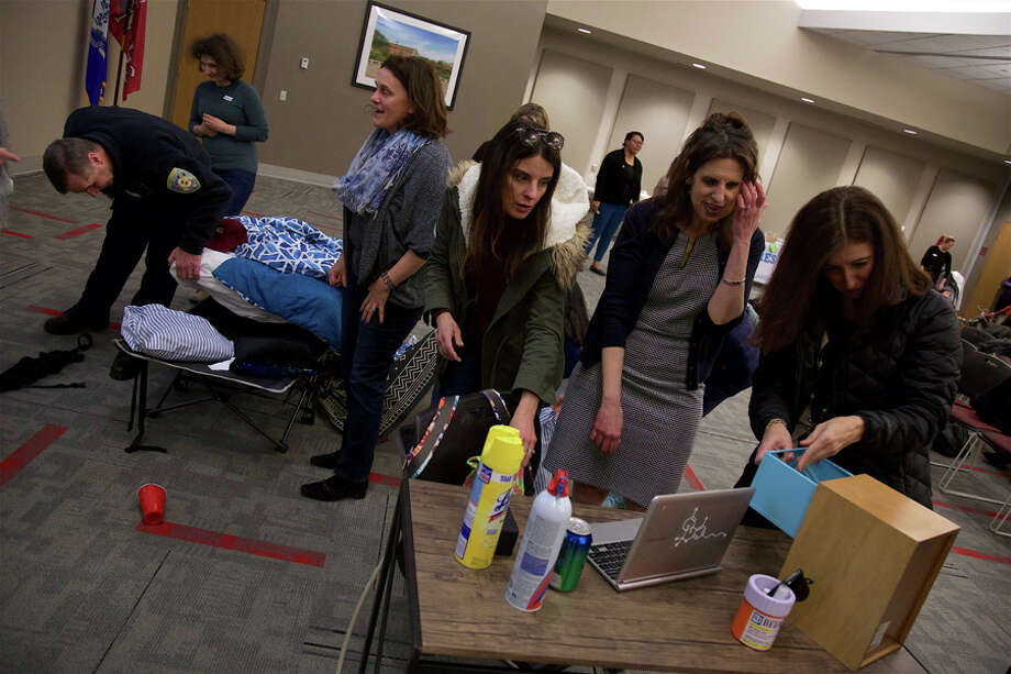 Signs of substance abuse are Hiding in Plain Sight. Parents search the mock bedroom for secrets in a demo at New Canaan High School Tuesday, March 26, learning how teens can easily hide evidence of substance abuse. — Jarret Liotta / For Hearst Connecticut Media / Connecticut Post